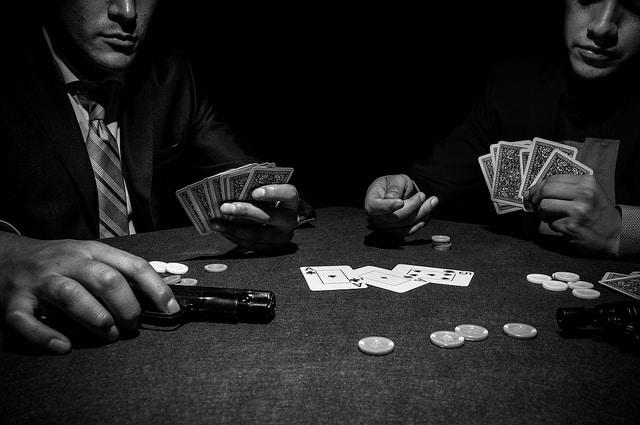 men gambling with guns